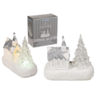 White polyresin church with christmas tree & warm,